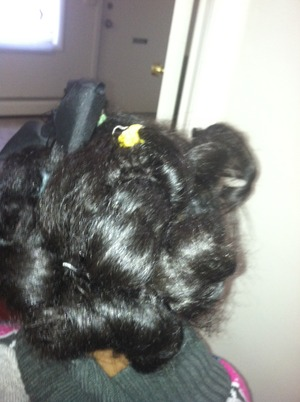Out rollers in her hair and then I use some pins to hold the curls