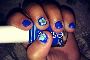 blue nails with a baby blue flower with rhinestones!! :)