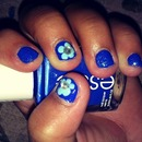 blue nails with flower accents!
