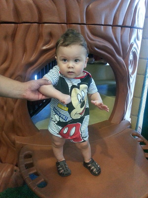 My baby boy posing with Mickey mouse outfit:)