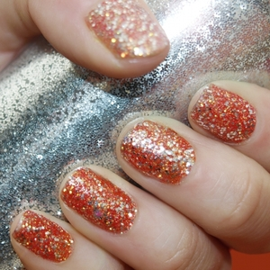 I used a mixture of craft glitter and glitter nail polish to achieve this look. I applied a bass coat of clear polish and sprinkled some super-fine coral mix craft glitter over it. I finished off the nails by applying two layers of silver glitter nail polish too add more texture and a stronger shine finish! Voila!
