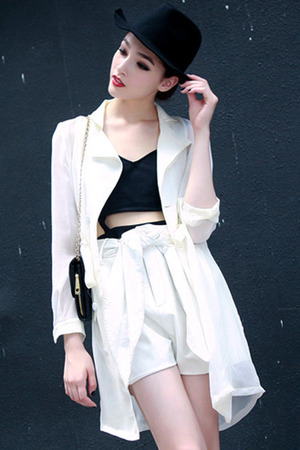 White trench coat, featuring shawl collar, long sleeve styling, self-tied design, buttoned front, solid color, loose fit, soft touch fabric. Goes with vest inner and self-tied shorts and boots for a photo.