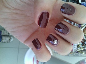 simple many with a nailpolosh by O.P.I. and a little stud