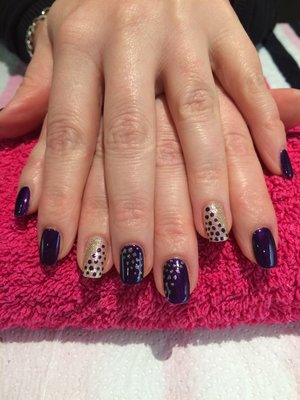 Gel nail art, purple, gold and glitter with polkadot detail.