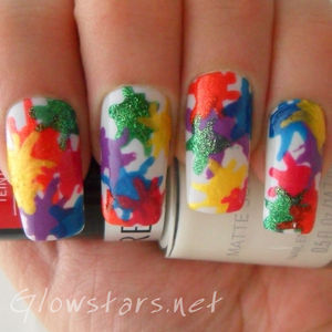 A splatter mani created using a dotting tool.