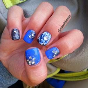 """I wasn't totally happy with my flower, but I love this blue! I believe it is """"Ocean Blue"""" by Sally Hansen Extreme Wear"""