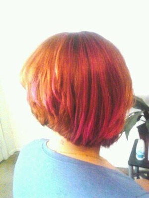 An asymmetrical bob I cut. 45 degrees, dropped on the right side. Blondor bleach for the foils. 7R base. All mixed with 30V developers.