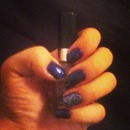midnight blue and glitter nails