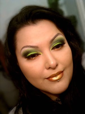 Lime green shadow and orange-gold lips