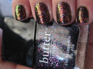 burning embers flakey nails :) butter london dark knight with pa nail polish aa38 layered on top   http://warmvanillasugar0823.blogspot.com/2012/02/notw-katniss-capitol-nails-butter.html
