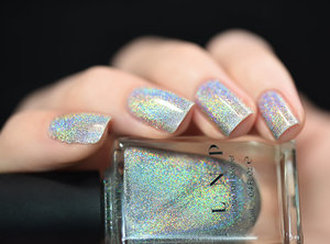 ILNP.com - MEGA (X) has a seriously over-the-top scattered holographic sparkle that's even visible indoors and is practically blinding in the sun!
