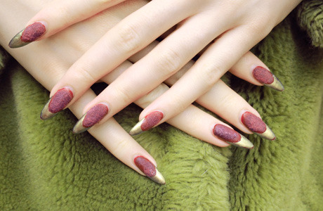 Stella is set for a classic Christmas in the Ciaté Velvet Manicure in Berry Poncho, and gold tips done in Chanel Peridot.