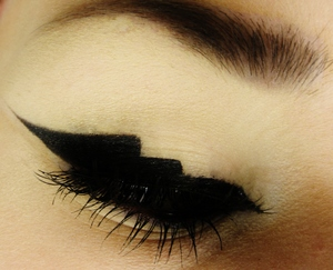 Adding a little bit of a twist to the classic winged eyeliner!   Like me on Facebook! http://www.facebook.com/pages/Makeup-Is-Art/455624517797347
