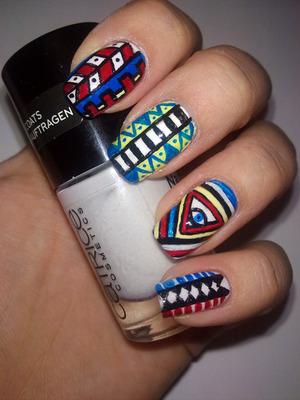 http://missbeautyaddict.blogspot.com/2012/03/31-days-challenge-tribal-nails.html