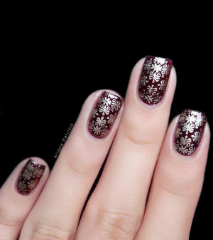 For this nail art, I used MoYou London Fashionista 08, Essie Good as Gold as the stamping polish, and China Glaze Conduct Yourself as the base color