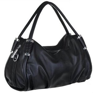 """Soft """"leather"""" ...roomy with silver hardware....comes with shoulder strap....an aliexpress find."""