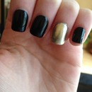 Gold ring finger and black