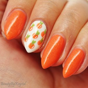 Color Me Monthly is a nail polish subscription, $7 per month, one shade per month. June's shade is Candied Clementine, juicy orange with a ton of golden flecks!
