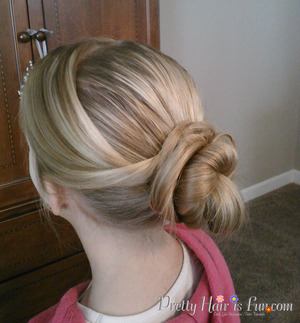 Cute and easy hair bun hairstyle! Check out my hairstyle tutorial on this at my YouTube channel: shaunellshair or Pretty Hair is Fun.