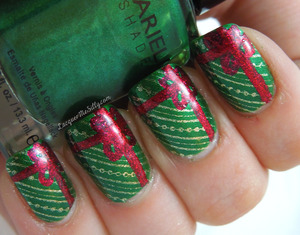 Gift Wrap Mani entry for week #2 of NailPolishCanda.com's Holiday Nail Art Challenge. For more details view my blog post here: http://www.lacquermesilly.com/2012/11/27/gift-wrap-mani/