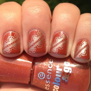https://polishmeplease.wordpress.com/2012/11/15/delicate-nails-31-days-of-inspired-nails/