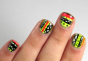 http://www.southernsparklenailart.blogspot.com/2014/01/aztec-tribal-nails.html