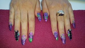 stiletto nails with 4 of my glitter mixes and some awesome spikes and gems for nail art