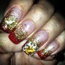 uñas rojo y doradi