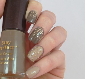 http://www.totally-nailed.com/2013/02/sequins-and-stud-ball-things.html
