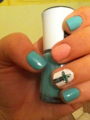 Aqua,baby pink & white with a black cross with glitter