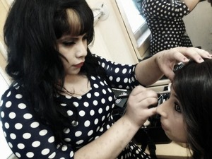 me doing makeup for a prom senior fashion show at my school