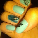 Turquoise and black feather nails