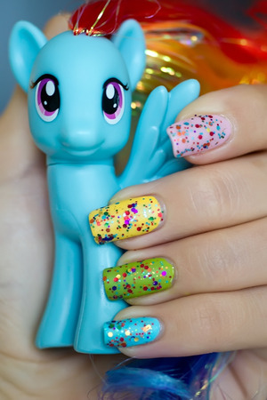 Rainbow Honey 20% Cooler over various colors; with matte top coat.