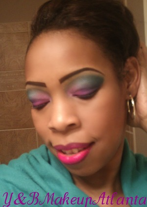 Colorful teal and purple eye. Black Radiance lipstick in Wild Orchid!