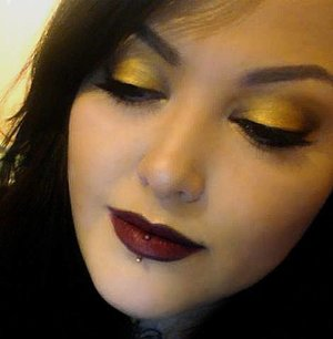 Gold shadow with a dark brick red lip