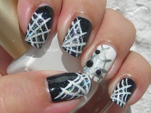 This might be the umpteenth time you've watched a spiderweb design this year. Enjoy!! :)