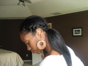 Half twist style on roller set natural hair. Check out my YT video on how to re-create this look http://youtu.be/ENWfl9da1uA