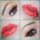 Neutral coral eyes and bold coral lips