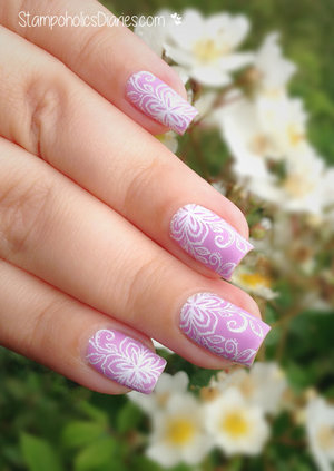 http://stampoholicsdiaries.com/2015/06/12/delicate-lavender-nails-with-sally-hansen-essence-and-chez-delaney/