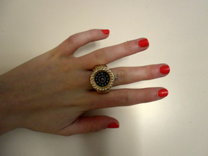 this ring is just awsome! I adore it :D the nail polish I'm using is called 402 by F.Flormar (just bought it from our local drugstore so I don't know if anyone knows the brand... because I don't :D)
