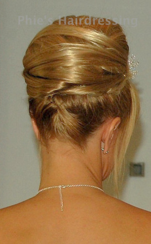 Wedding hair. this lady had a short bob. but wanted this, i used 2 wefts of extensions and padding