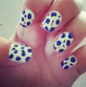 Used tooth picks to place the black polish around the blue dots.
