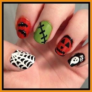 They're a little bit messy as I'd only just done them but here are my Halloween nails :D I <3 them.