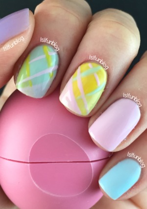 Gel polish in pastel colors with simple plaid pattern