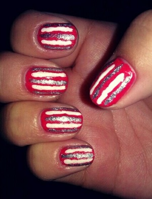 tangerine orange nails with simply white and silver stripes! :)