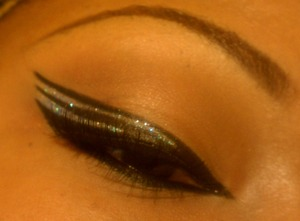 Three winged liner with sparkle is perfect for a holiday party. New Year's Eve, anyone?