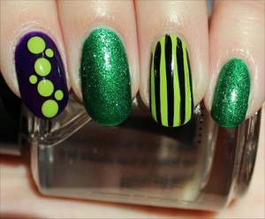 See more swatches & mini reviews of each here: http://www.swatchandlearn.com/nail-art-green-fiend-nails  I used 3 colours from the China Glaze Cirque du Soleil Collection: Running in Circles (glittery green), DEF Defying (green creme), and Creative Fantasy (purple).