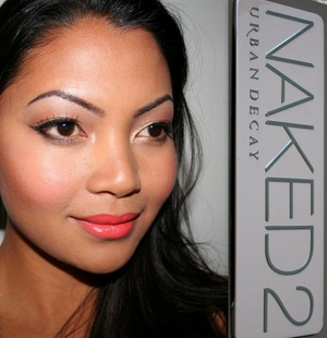 Urban Decay Naked 2 palette on the eyes and Wet n Wild Mega Last lip color in 24 Carrot Gold