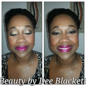 Gold and brown eyeshadow with bold lips