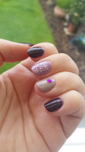Pretty purple with lilac glitter and a little gem.